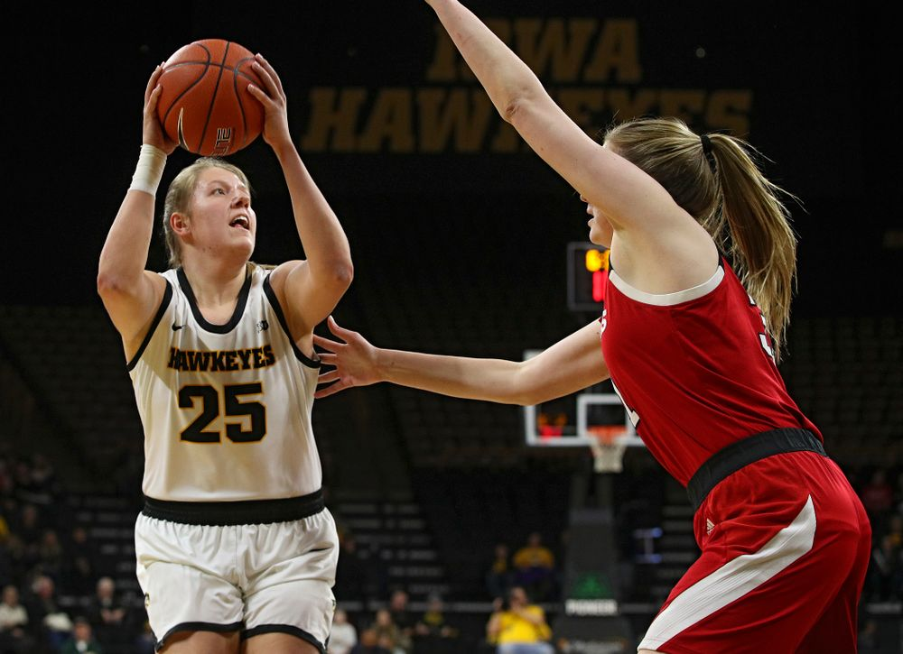Iowa Hawkeyes forward Monika Czinano (25) goes up for a basket during the first quarter of the game at Carver-Hawkeye Arena in Iowa City on Thursday, February 6, 2020. (Stephen Mally/hawkeyesports.com)