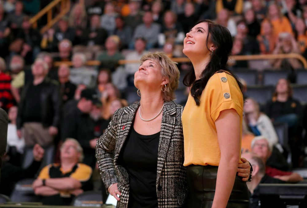 Megan Gustafson watches a video with head coach Lisa Bluder during a jersey retirement ceremony Sunday, January 26, 2020 at Carver-Hawkeye Arena. (Brian Ray/hawkeyesports.com)