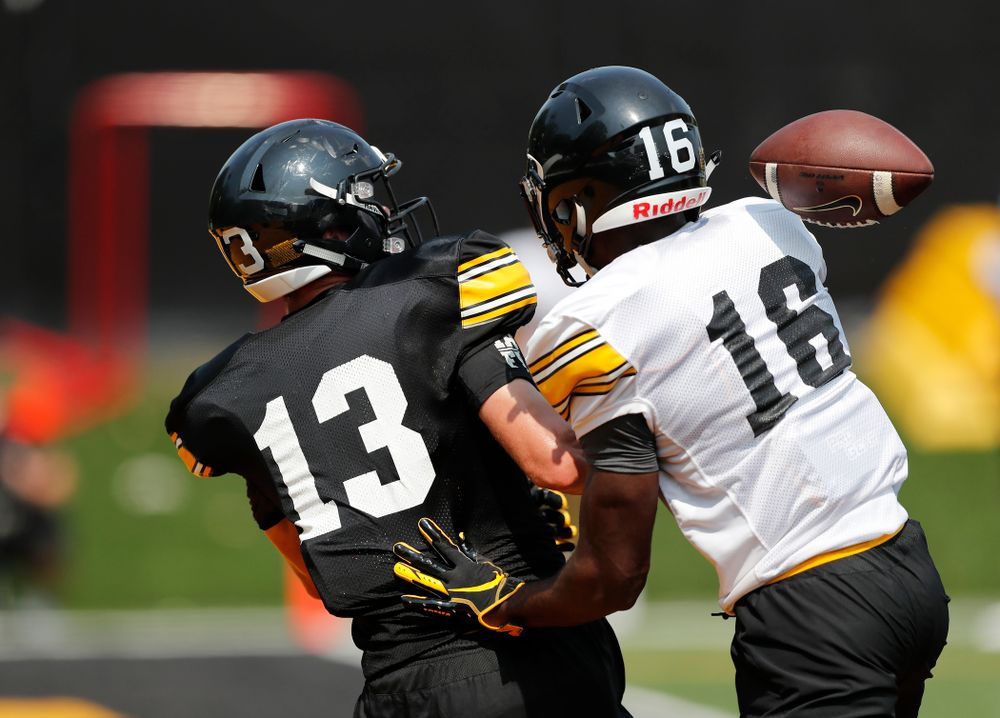 Iowa Hawkeyes defensive back Terry Roberts (16) and wide receiver Henry Marchese (13) during fall camp practice No. 9 Friday, August 10, 2018 at the Kenyon Practice Facility. (Brian Ray/hawkeyesports.com)