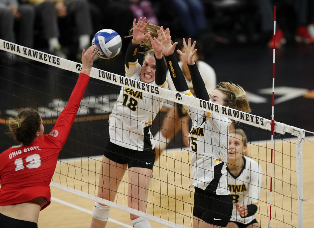 Iowa Hawkeyes middle blocker Hannah Clayton (18) and outside hitter Meghan Buzzerio (5) against the Ohio State Buckeyes Saturday, November 24, 2018 at Carver-Hawkeye Arena. (Brian Ray/hawkeyesports.com)