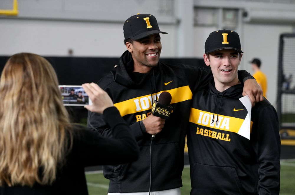 Iowa Hawkeyes infielder Lorenzo Elion (1) interviews outfielder Justin Jenkins (6) during their annual media day Thursday, February 6, 2020 at the Indoor Practice Facility. (Brian Ray/hawkeyesports.com)