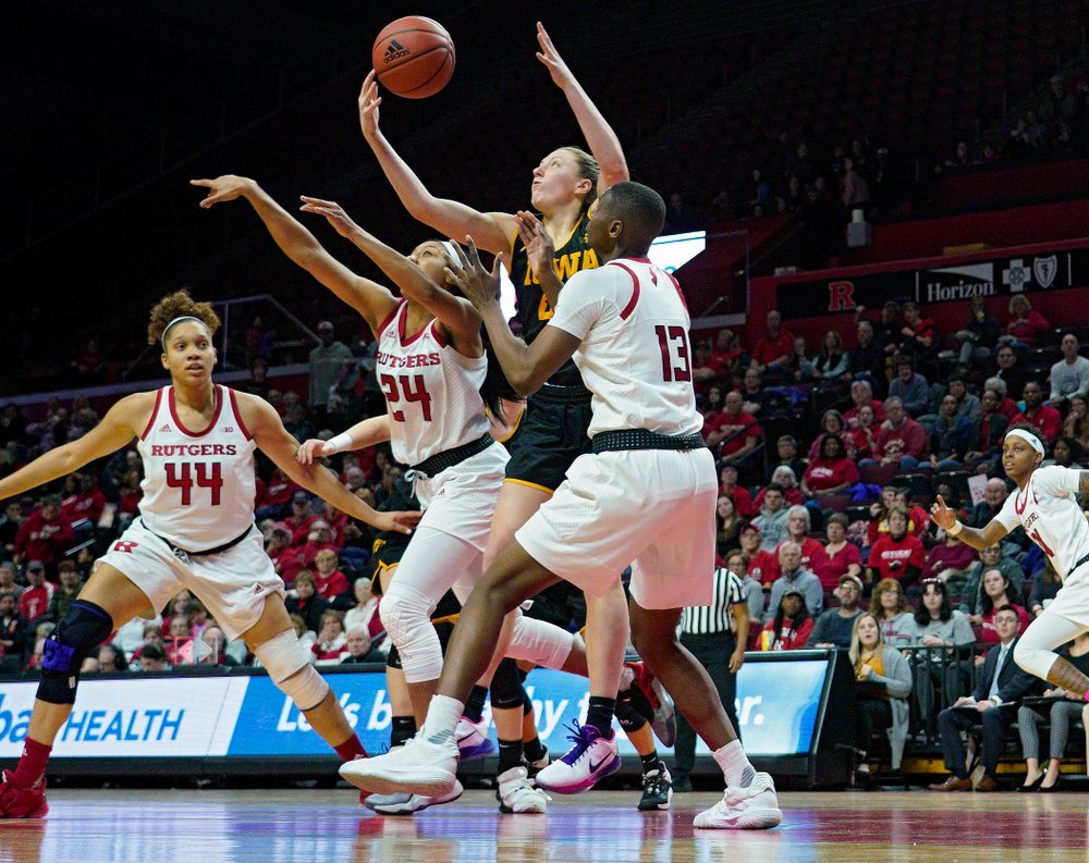 Iowa forward Amanda Ollinger (43) pulls in a rebound during the third quarter of their game at the Rutgers Athletic Center in Piscataway, N.J. on Sunday, March 1, 2020. (Stephen Mally/hawkeyesports.com)