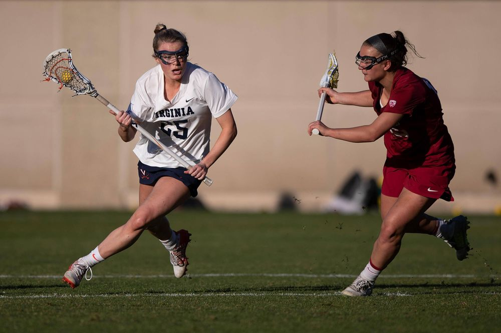 STANFORD, California - FEBRUARY 14: Virginia Cavaliers midfield Courtlynne Caskin (25) is defended by Stanford Cardinal midfield Chelsea Trattner (16) during the second half at Cagan Stadium on February 14, 2020 in Stanford, California. The Virginia Cavaliers defeated the Stanford Cardinal 12-11. (Photo by Jason O. Watson)