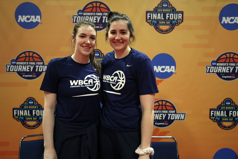 Iowa Hawkeyes forward Megan Gustafson (10) and Iowa State's Bridget Carleton after signing autographs with the other WBCA All Americans at the Tourney Town Fan Fest Friday, April 5, 2019 at the Tampa Convention Center in Tampa, FL. (Brian Ray/hawkeyesports.com)