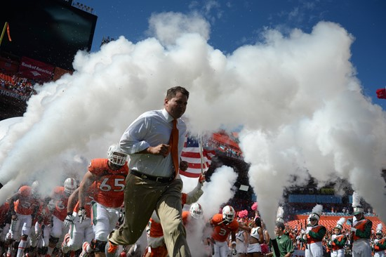 University of Miami Hurricanes head coach Al Golden leads his team on the field in a game against the Georgia Tech Yellow Jackets at Sun Life Stadium...