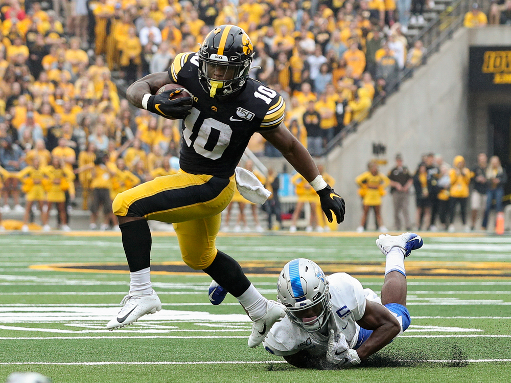 Iowa Hawkeyes running back Mekhi Sargent (10) pulls away from a tackle during the second quarter of their game at Kinnick Stadium in Iowa City on Saturday, Sep 28, 2019. (Stephen Mally/hawkeyesports.com)
