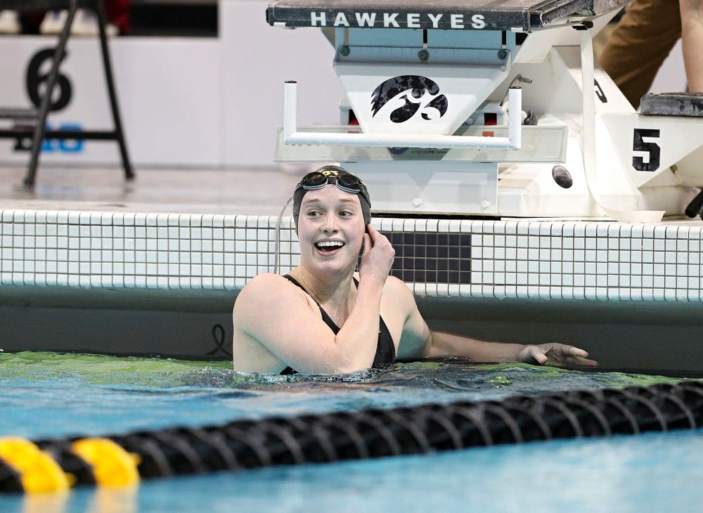 Iowa's Kelsey Drake reacts as she looks a the video board and sees she broke a school record in a 200 yard butterfly time trial during the 2020 Big Ten Women's Swimming and Diving Championships at the Campus Recreation and Wellness Center in Iowa City on Wednesday, February 19, 2020. (Stephen Mally/hawkeyesports.com)