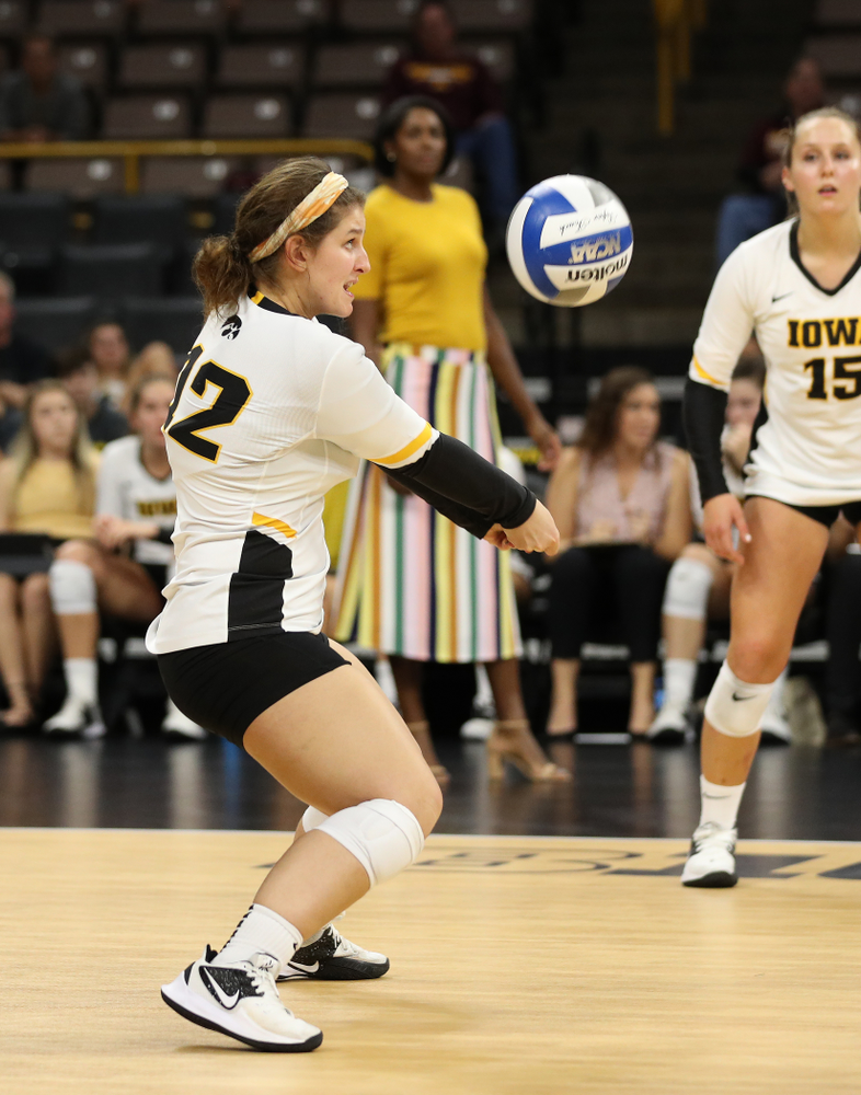 Iowa Hawkeyes defensive specialist Emily Bushman (12) against the Minnesota Golden Gophers Wednesday, October 2, 2019 at Carver-Hawkeye Arena. (Brian Ray/hawkeyesports.com)