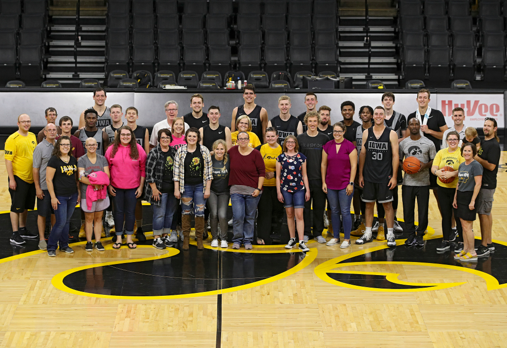 The Iowa Hawkeyes Men's Basketball team and visitors from the University of Iowa Hospitals and Clinics Adolescent and Young Adult (AYA) Cancer Program at Carver-Hawkeye Arena in Iowa City on Monday, Sep 30, 2019. (Stephen Mally/hawkeyesports.com)