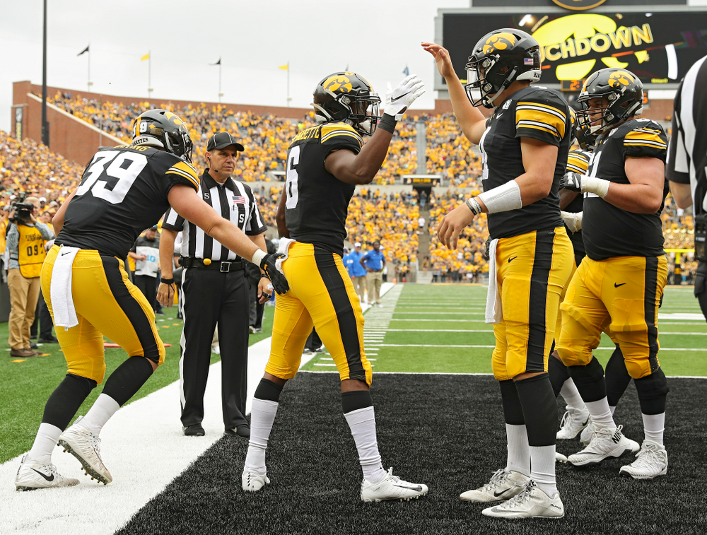 Iowa Hawkeyes wide receiver Ihmir Smith-Marsette (6) celebrates his 14-yard touchdown run with quarterback Nate Stanley (4) during third quarter of their game at Kinnick Stadium in Iowa City on Saturday, Sep 28, 2019. (Stephen Mally/hawkeyesports.com)