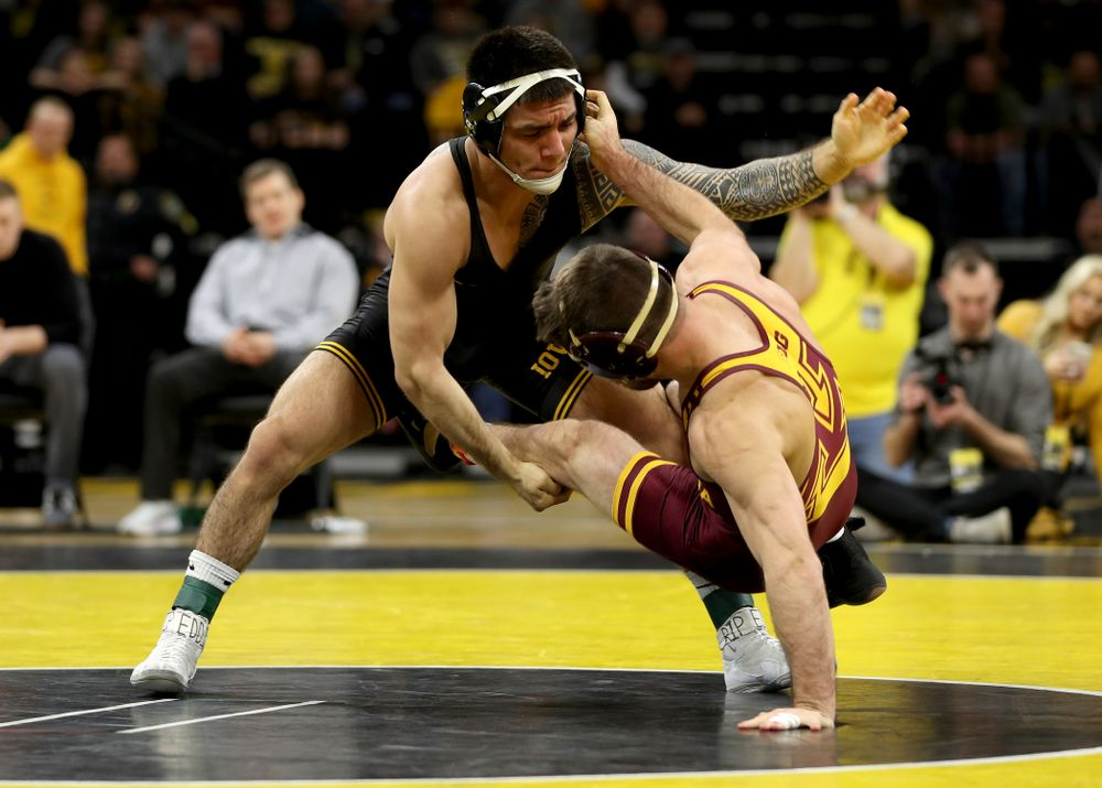 Iowa's Pat Lugo wrestles Minnesota's Brayton Lee at 149 pounds Saturday, February 15, 2020 at Carver-Hawkeye Arena. Lugo won the match 3-2. (Brian Ray/hawkeyesports.com)