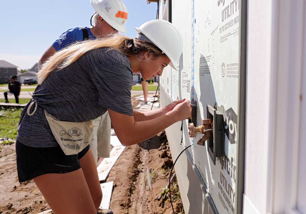Iowa's Megan Meyer works on siding on a Habitat for Humanity Women Build project in Iowa City on Wednesday, Sep 25, 2019. (Stephen Mally/hawkeyesports.com)