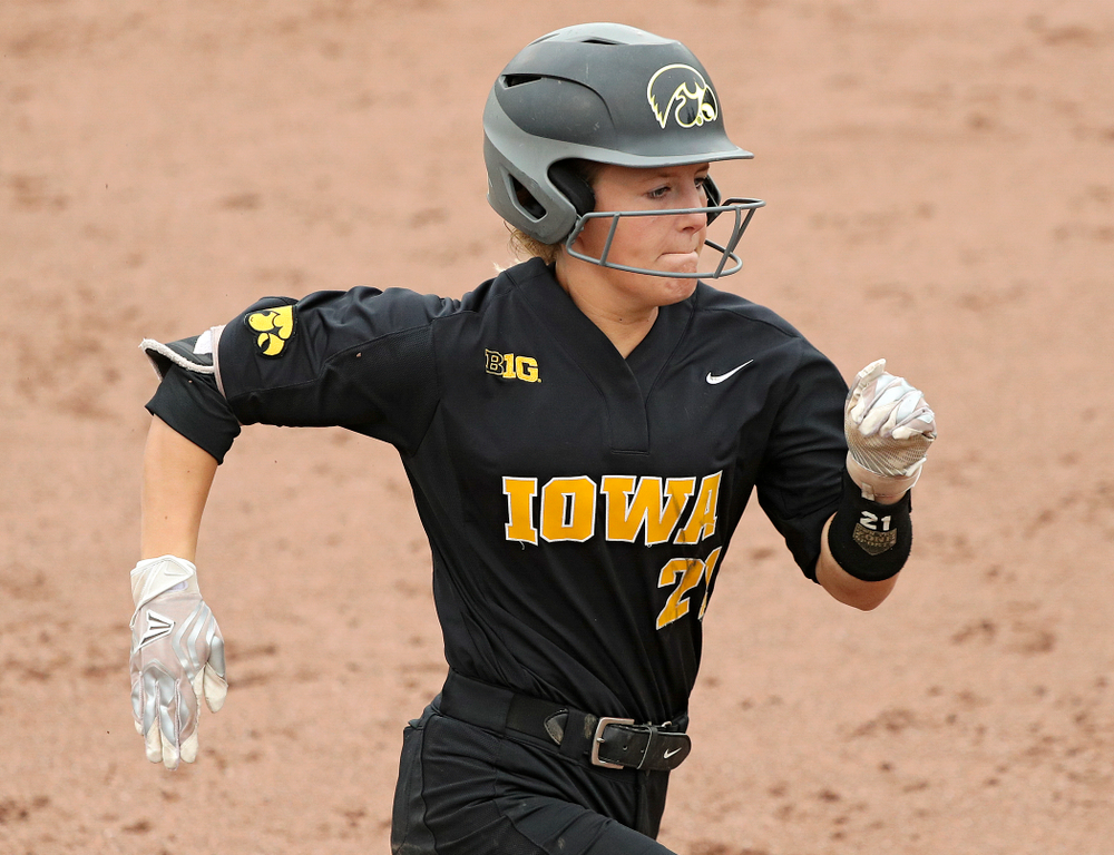 Iowa outfielder Havyn Monteer (21) runs to first after laying down a bunt single during the fifth inning of their game against Iowa Softball vs Indian Hills Community College at Pearl Field in Iowa City on Sunday, Oct 6, 2019. (Stephen Mally/hawkeyesports.com)