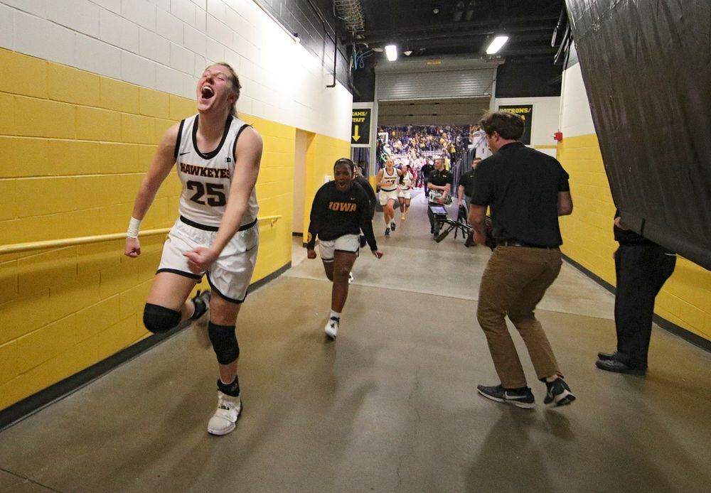 Iowa Hawkeyes forward Monika Czinano (25) celebrates as she runs back to the locker room after their double overtime win at Carver-Hawkeye Arena in Iowa City on Sunday, January 12, 2020. (Stephen Mally/hawkeyesports.com)