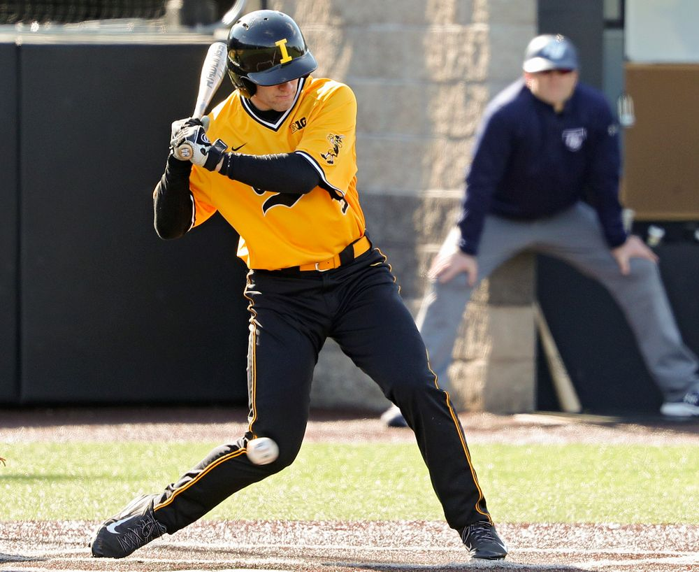 Iowa Hawkeyes designated hitter Austin Martin (34) is hit by a pitch during the first inning of their game at Duane Banks Field in Iowa City on Tuesday, Apr. 2, 2019. (Stephen Mally/hawkeyesports.com)