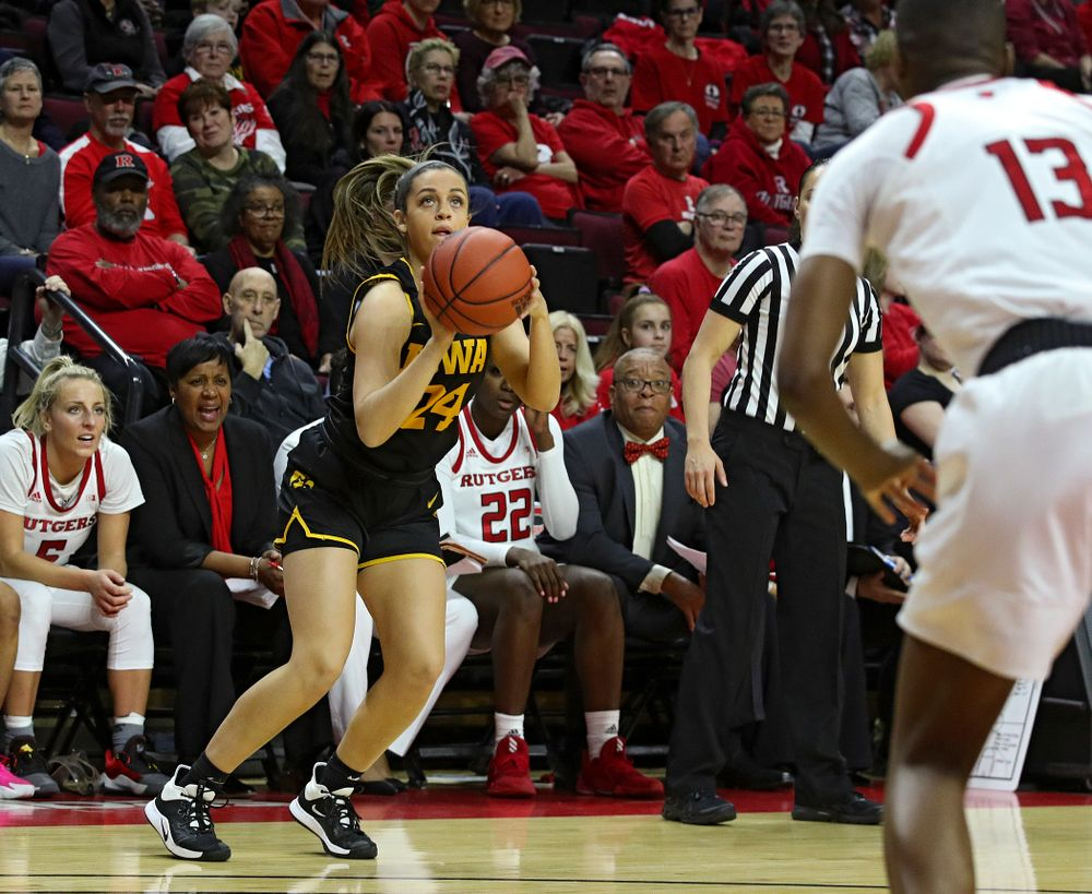 Iowa guard Gabbie Marshall (24) makes a 3-pointer during the first quarter of their game at the Rutgers Athletic Center in Piscataway, N.J. on Sunday, March 1, 2020. (Stephen Mally/hawkeyesports.com)
