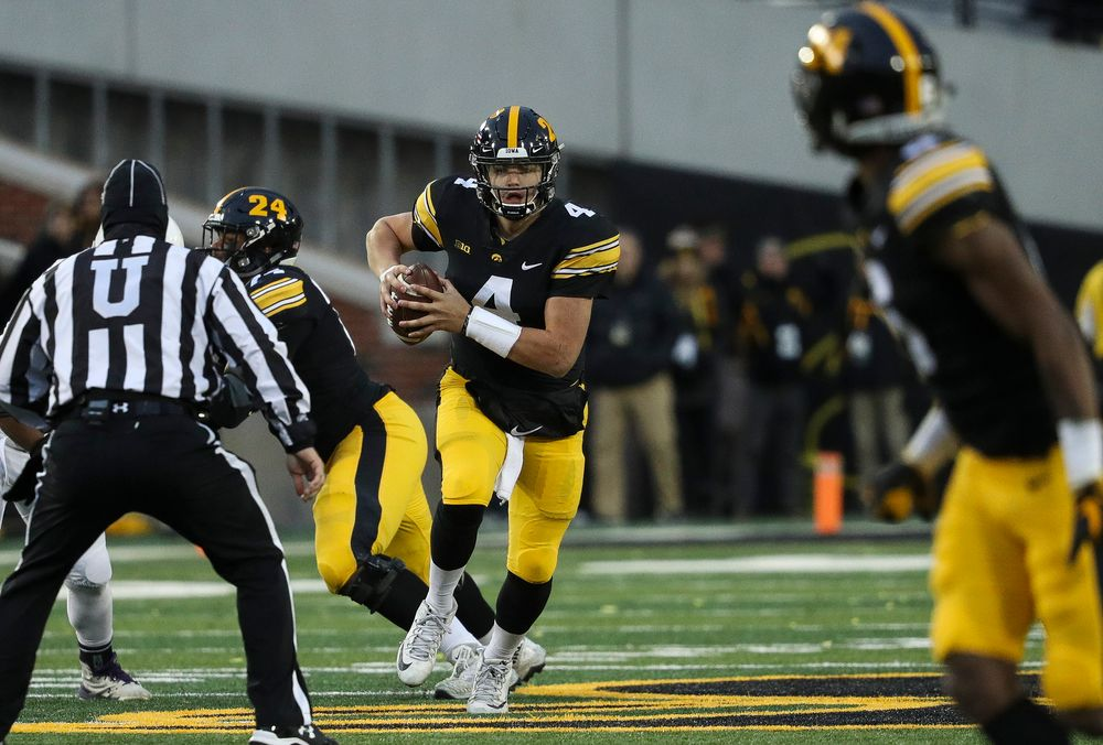 Iowa Hawkeyes quarterback Nate Stanley (4) scrambles in the pocket during a game against Northwestern at Kinnick Stadium on November 10, 2018. (Tork Mason/hawkeyesports.com)