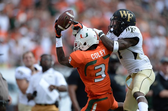 University of Miami Hurricanes defensive back Tracy Howard #3 catches a pass in a game against the Wake Forest Demon Deacons at Sun Life Stadium on...