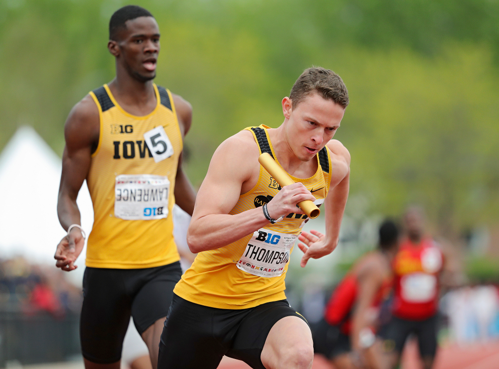 Iowa's Chris Thompson (right) takes off after receiving the baton from Wayne Lawrence Jr. during the 1600 meter relay event on the third day of the Big Ten Outdoor Track and Field Championships at Francis X. Cretzmeyer Track in Iowa City on Sunday, May. 12, 2019. (Stephen Mally/hawkeyesports.com)