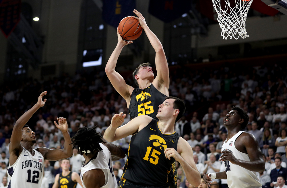 Iowa Hawkeyes forward Luka Garza (55) grabs a rebound against Penn State Saturday, January 4, 2020 at the Palestra in Philadelphia. (Brian Ray/hawkeyesports.com)