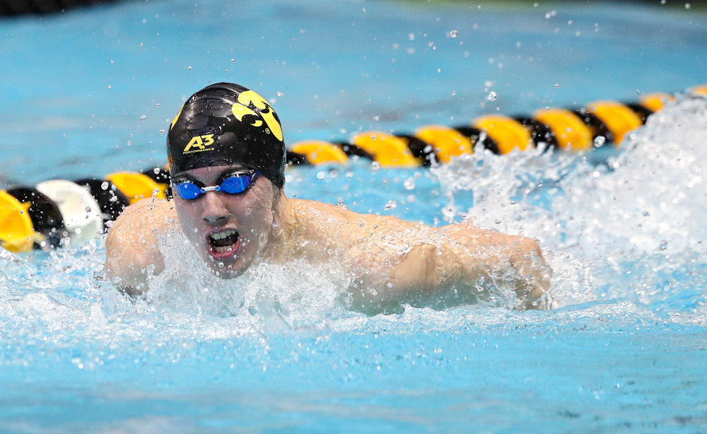 Iowa's Dolan Craine swims the men's 200-yard butterfly event during their meet against Michigan State and Northern Iowa at the Campus Recreation and Wellness Center in Iowa City on Friday, Oct 4, 2019. (Stephen Mally/hawkeyesports.com)