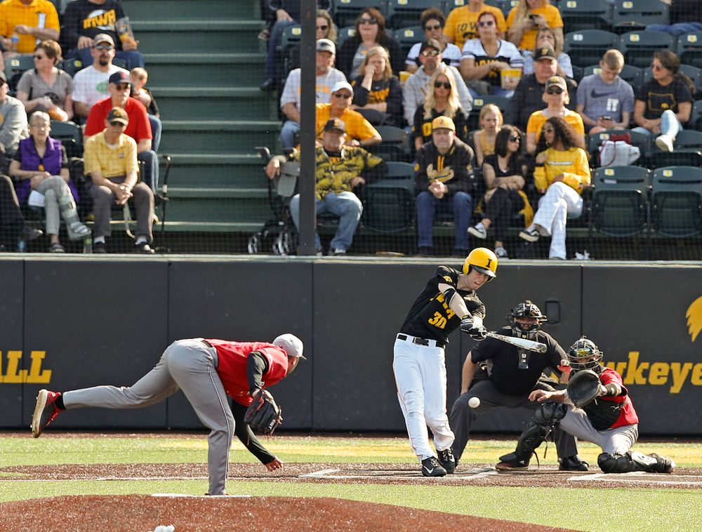 Iowa Hawkeyes right fielder Connor McCaffery (30) drives a pitch for a hit during the seventh inning of their game against Rutgers at Duane Banks Field in Iowa City on Saturday, Apr. 6, 2019. (Stephen Mally/hawkeyesports.com)