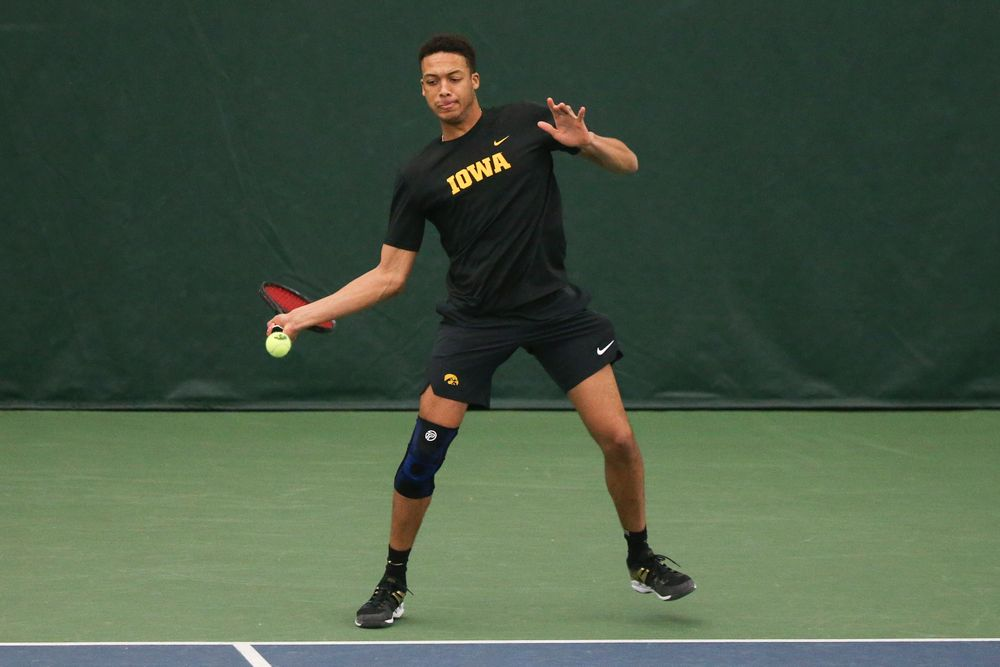 Iowa's Oliver Okonkwo returns a hit during the Iowa men's tennis meet vs VCU  on Saturday, February 29, 2020 at the Hawkeye Tennis and Recreation Complex. (Lily Smith/hawkeyesports.com)