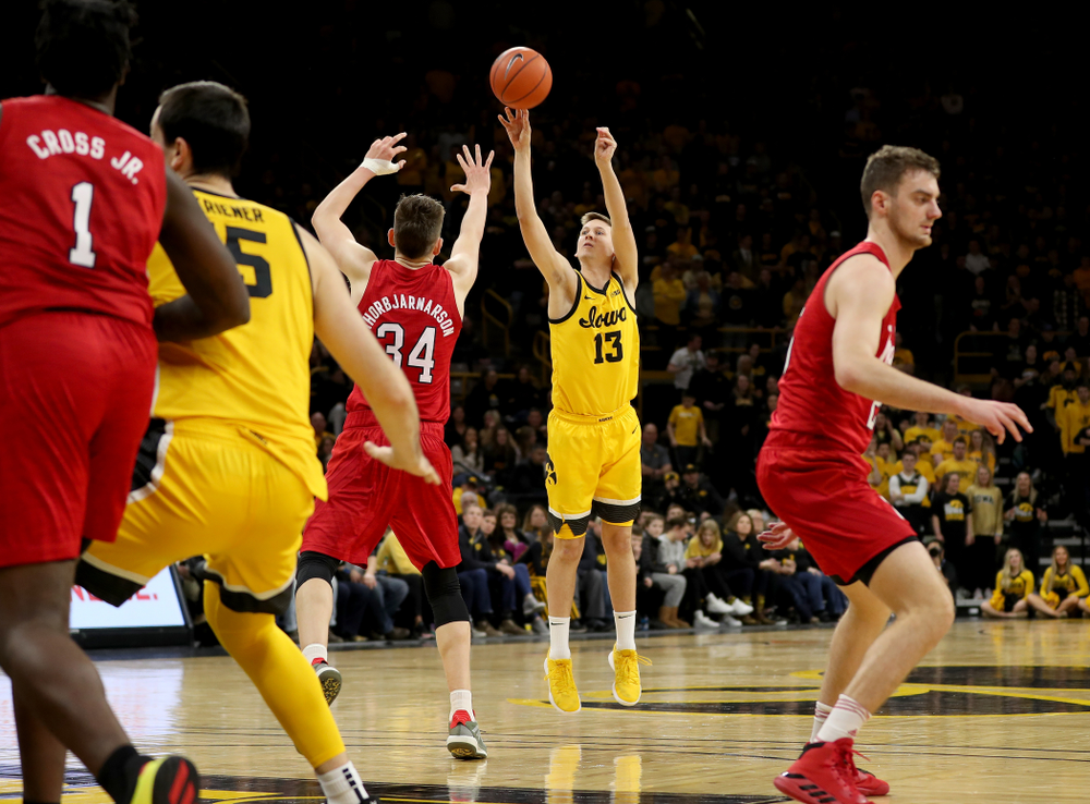 Iowa Hawkeyes guard Austin Ash (13) knocks down a three point basket against the Nebraska Cornhuskers Saturday, February 8, 2020 at Carver-Hawkeye Arena. (Brian Ray/hawkeyesports.com)