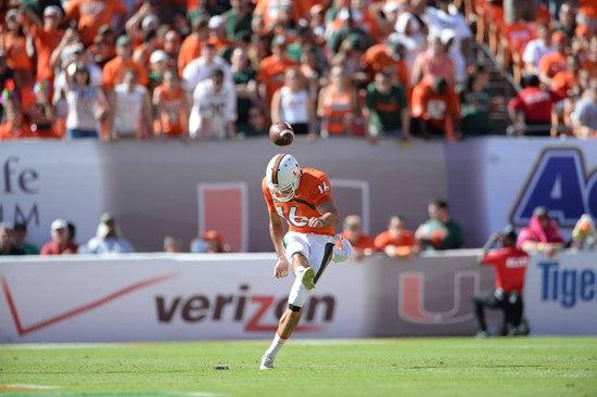 University of Miami Hurricanes quarterback Garrison Lassiter #16 plays in a game against the Georgia Tech Yellow Jackets at Sun Life Stadium on...