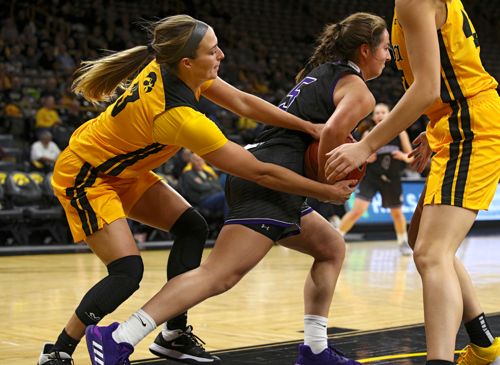 Iowa guard Makenzie Meyer (3) keeps her hands on a tied ball during the fourth quarter of their game against Winona State at Carver-Hawkeye Arena in Iowa City on Sunday, Nov 3, 2019. (Stephen Mally/hawkeyesports.com)