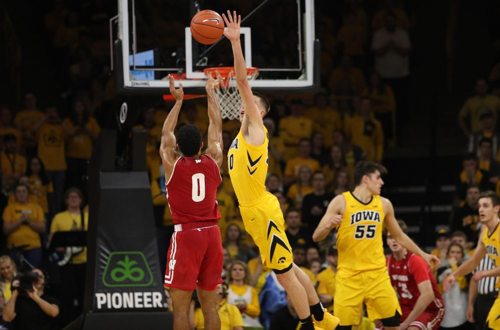 Iowa Hawkeyes guard Joe Wieskamp (10) blocks a shot against the Wisconsin Badgers Friday, November 30, 2018 at Carver-Hawkeye Arena. (Brian Ray/hawkeyesports.com)