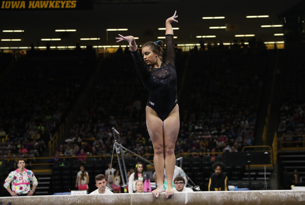 Iowa's Dani Castillo competes on the beam against Michigan Friday, February 14, 2020 at Carver-Hawkeye Arena. (Brian Ray/hawkeyesports.com)