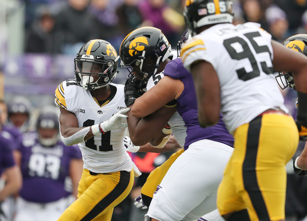 Iowa Hawkeyes defensive end Chauncey Golston (57) intercepts a pass against the Northwestern Wildcats Saturday, October 26, 2019 at Ryan Field in Evanston, Ill. (Brian Ray/hawkeyesports.com)