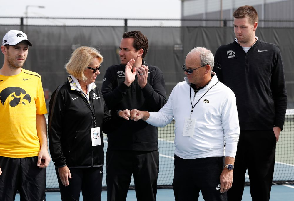 Kirk and Diane Mellecker, of Park City, Utah, are recognized with the Hawkeyes before their game against Northwestern in the first round of the 2018 Big Ten Men's Tennis Tournament Thursday, April 26, 2018 at the Hawkeye Tennis and Recreation Complex. (Brian Ray/hawkeyesports.com)
