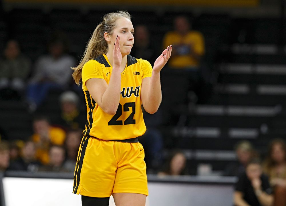 Iowa Hawkeyes guard Kathleen Doyle (22) claps during the fourth quarter of their game at Carver-Hawkeye Arena in Iowa City on Thursday, January 23, 2020. (Stephen Mally/hawkeyesports.com)