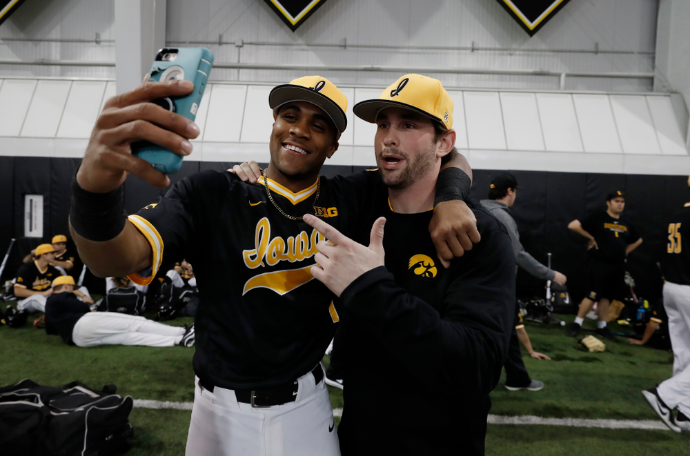 Iowa Hawkeyes third baseman Lorenzo Elion (1) and infielder Chris Whelan (28) during the team's annual media day Thursday, February 8, 2018 in the indoor practice facility. (Brian Ray/hawkeyesports.com)