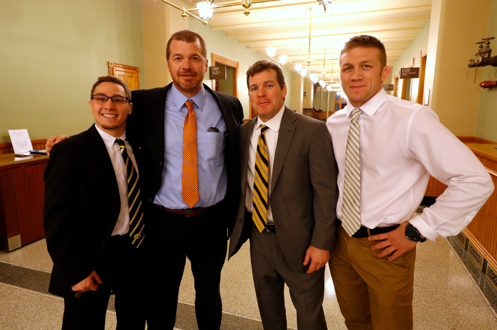 Hawkeye Wrestling head coach Tom Brands, assistant coach Ryan Morningstar, national champion at 125 pounds Spencer Lee, Troy Skinner