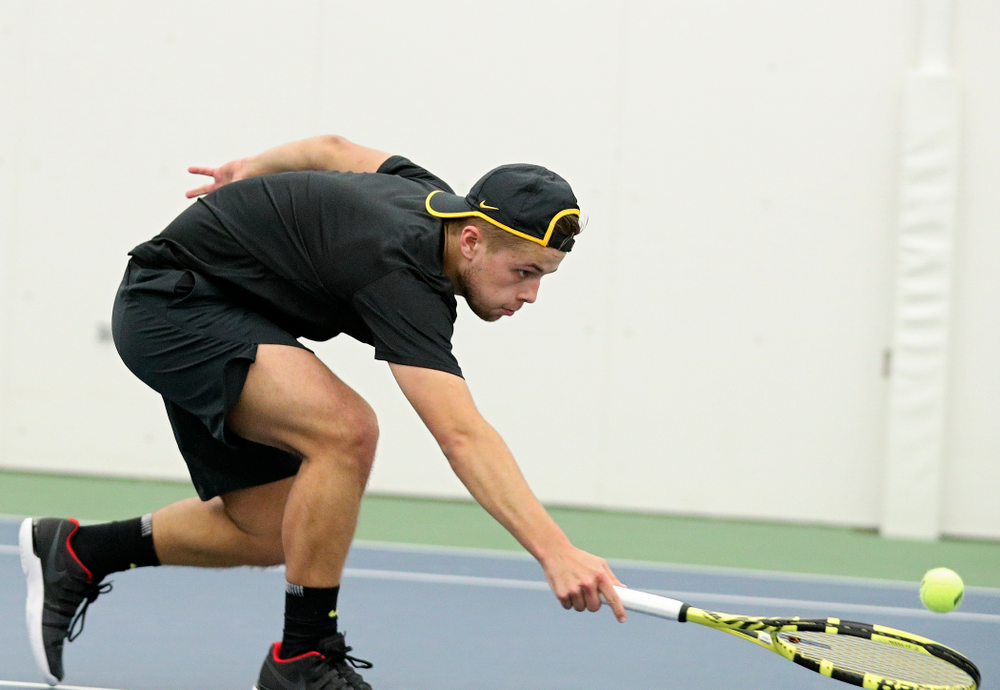 Iowa's Will Davies reaches a ball during their match at the Hawkeye Tennis and Recreation Complex in Iowa City on Thursday, January 16, 2020. (Stephen Mally/hawkeyesports.com)