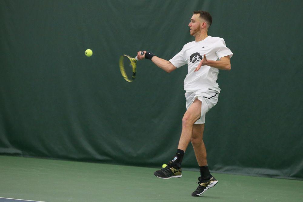 Iowa's Kareem Allaf returns a hit during the Iowa men's tennis meet vs Nebraska on Sunday, March 1, 2020 at the Hawkeye Tennis and Recreation Complex. (Lily Smith/hawkeyesports.com)