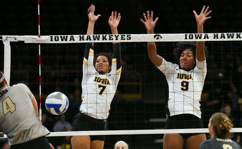 Iowa Hawkeyes setter Brie Orr (7) and Iowa Hawkeyes middle blocker Amiya Jones (9) block an attack during a game against Purdue at Carver-Hawkeye Arena on October 13, 2018. (Tork Mason/hawkeyesports.com)