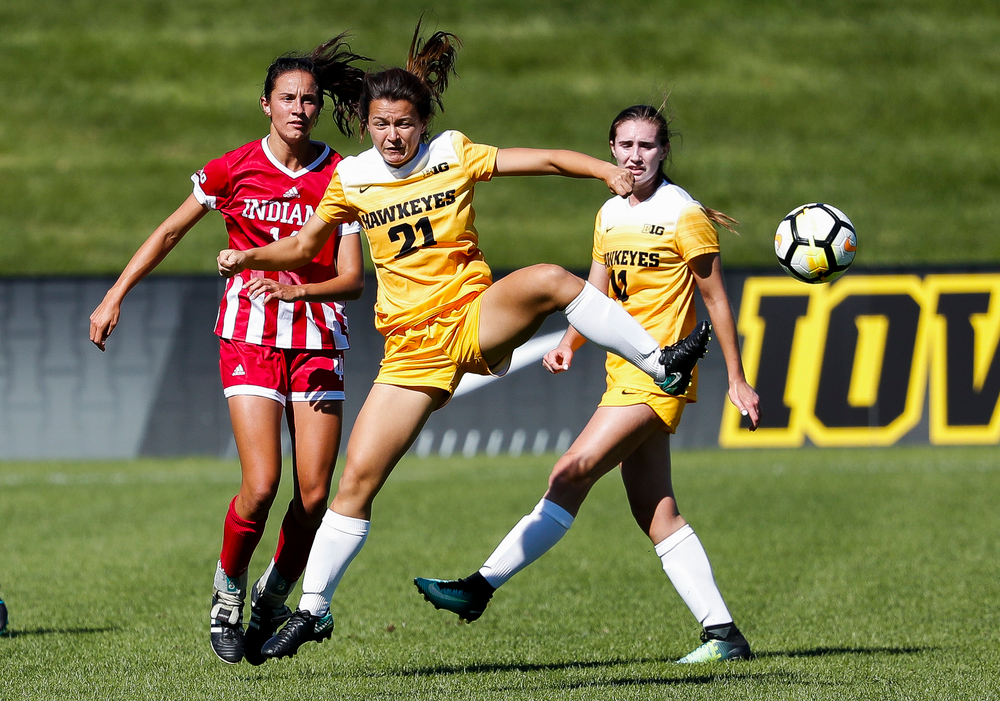 Iowa Hawkeyes forward Emma Tokuyama (21) heads the ball during a game against Indiana at the Iowa Soccer Complex on September 23, 2018. (Tork Mason/hawkeyesports.com)