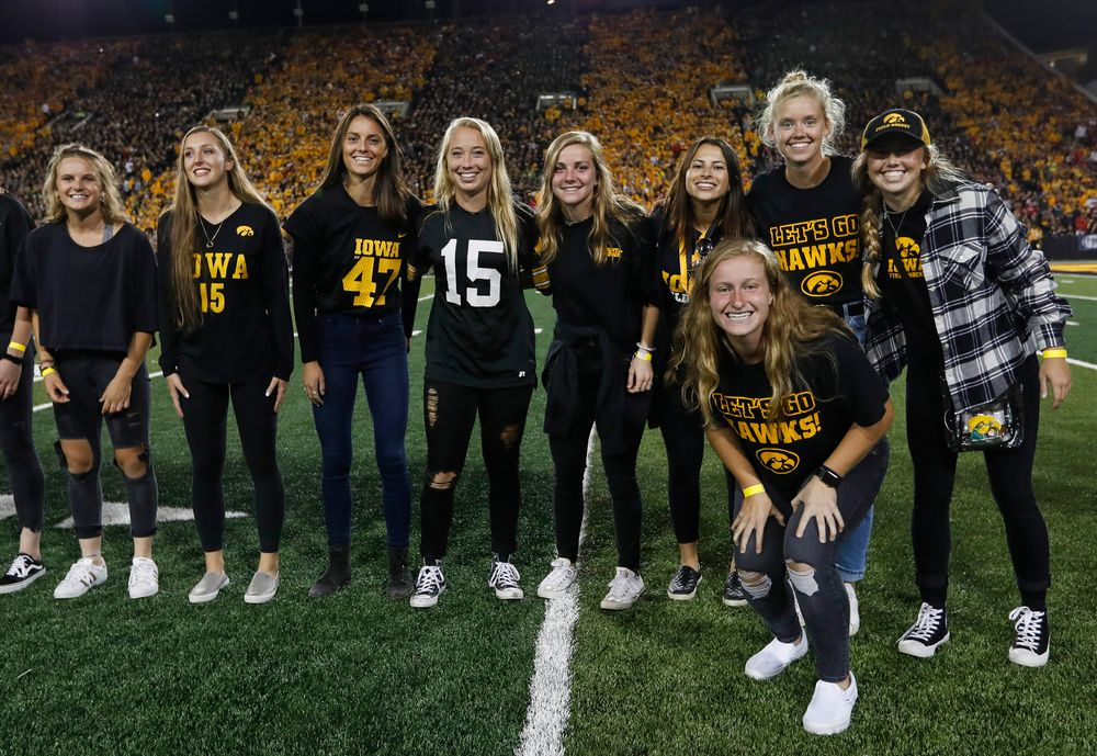 Members of the Iowa field hockey team are recognized by the Presidential Committee on Athletics at halftime during a game against Wisconsin on September 22, 2018. (Tork Mason/hawkeyesports.com)
