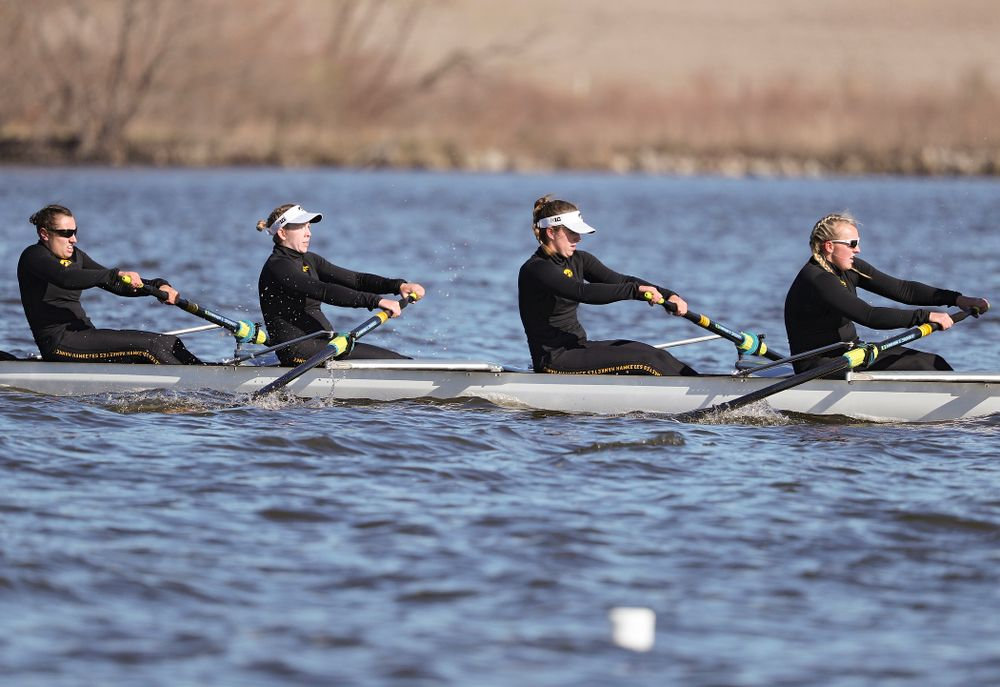 Iowa's Rachel Kram (from left), Lauren Collier, Noelle Ossenkop, and Erika Davidson during their I Novice 8 race against Wisconsin in their Big Ten Double Dual Rowing Regatta at Lake Macbride in Solon on Saturday, Apr. 13, 2019. (Stephen Mally/hawkeyesports.com)