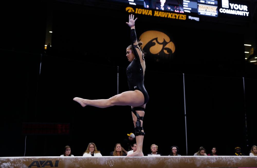 Iowa's Rose Piorkowski competes on the beam