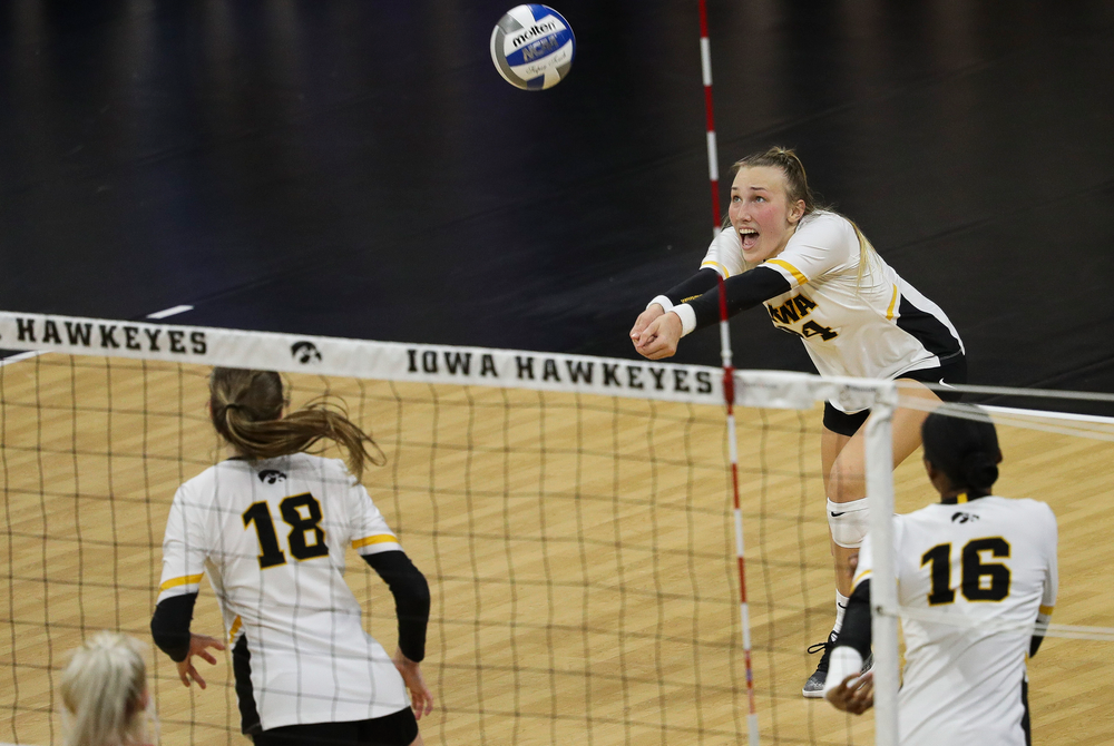Iowa Hawkeyes outside hitter Cali Hoye (14) bumps the ball during a match against Rutgers at Carver-Hawkeye Arena on November 2, 2018. (Tork Mason/hawkeyesports.com)