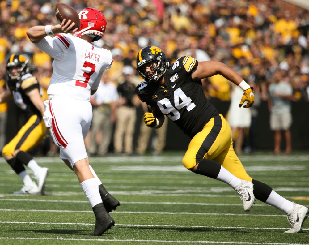 Iowa Hawkeyes defensive end A.J. Epenesa (94) chases Rutgers quarterback McLane Carter (3) during the first quarter of their Big Ten Conference football game at Kinnick Stadium in Iowa City on Saturday, Sep 7, 2019. (Stephen Mally/hawkeyesports.com)