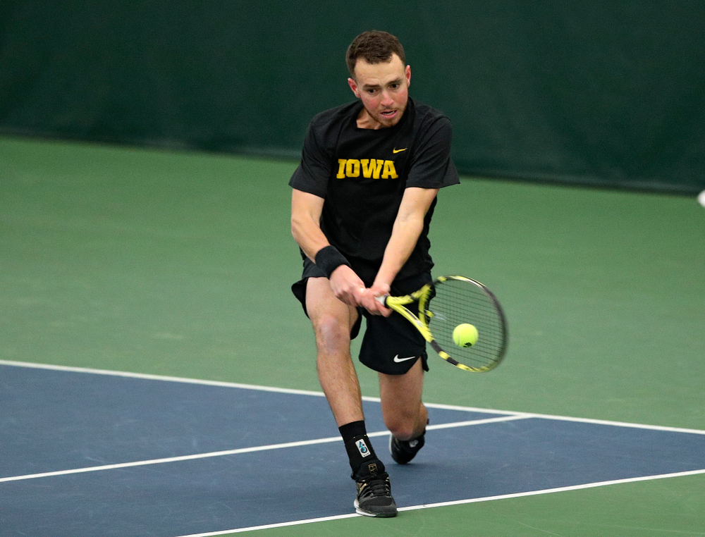 Iowa's Kareem Allaf returns a shot during his doubles match at the Hawkeye Tennis and Recreation Complex in Iowa City on Friday, March 6, 2020. (Stephen Mally/hawkeyesports.com)