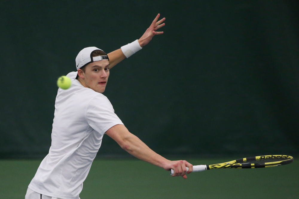 Iowa's Joe Tyler returns a hit during the Iowa men's tennis meet vs Nebraska on Sunday, March 1, 2020 at the Hawkeye Tennis and Recreation Complex. (Lily Smith/hawkeyesports.com)