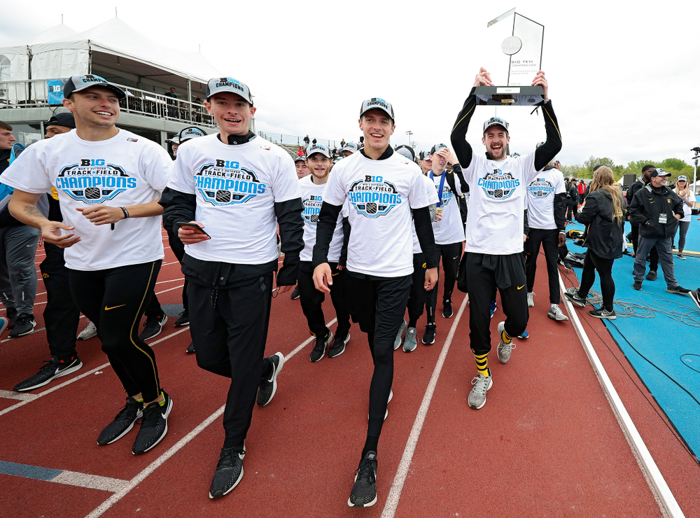 Iowa's Nolan Teubel holds up their team trophy as he takes a trip around the track with his teammates after winning the Men's Big Ten Outdoor Track and Field Championships on the third day of the Big Ten Outdoor Track and Field Championships at Francis X. Cretzmeyer Track in Iowa City on Sunday, May. 12, 2019. (Stephen Mally/hawkeyesports.com)