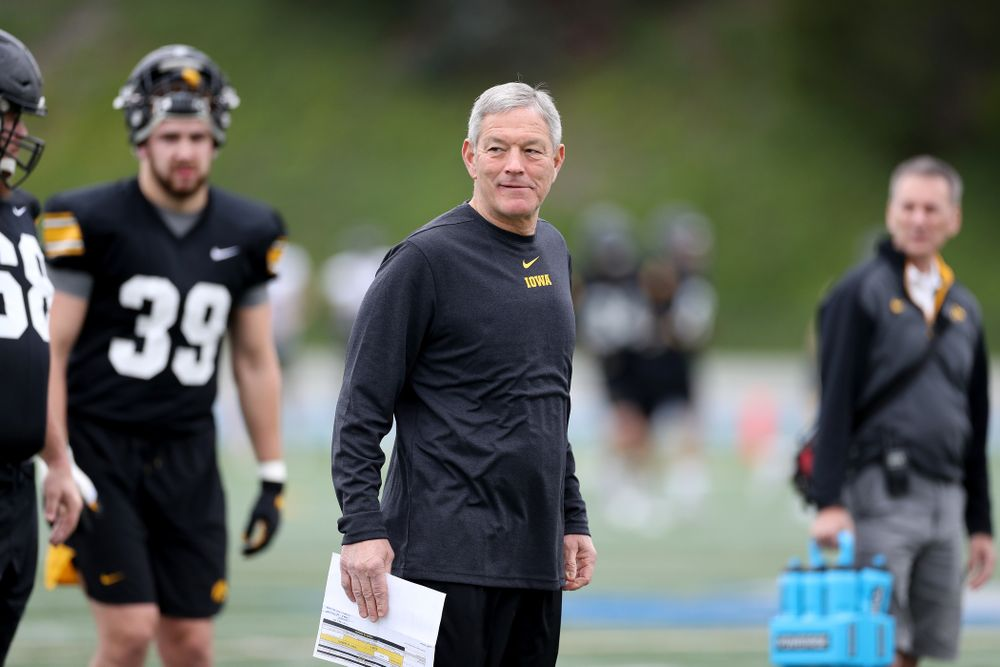 Iowa Hawkeyes head coach Kirk Ferentz smiles during practice Sunday, December 22, 2019 at Mesa College in San Diego. (Brian Ray/hawkeyesports.com)
